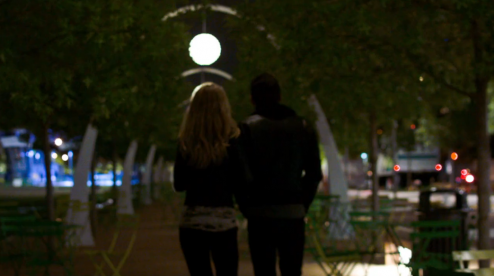 couple walking in Klyde Warren Park